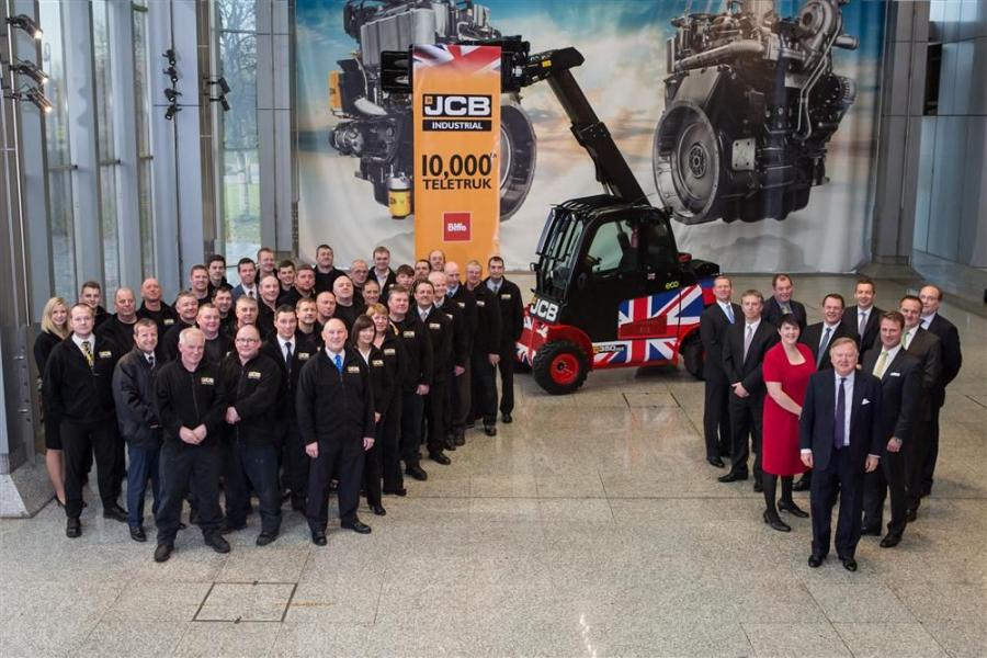 Lord Bamford (front, right) joins in the celebration to mark the production of JCB's 10,000th Teletruk.