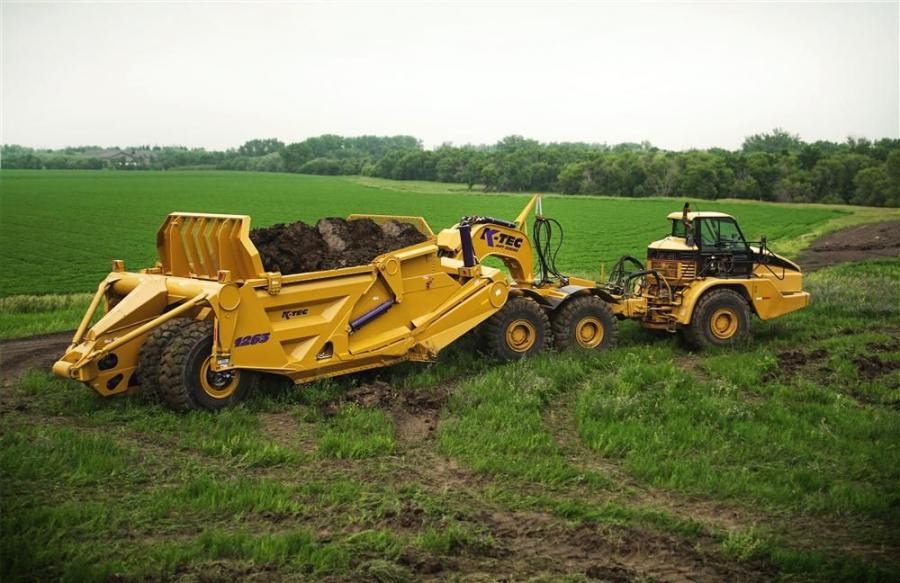 With a heaped capacity of 63 cu. yds. (48 cu m) and empty tare weight of 61,000 lbs. (27,669 kg), the K-Tec 1263 ADT is built for massive dirt moving projects.