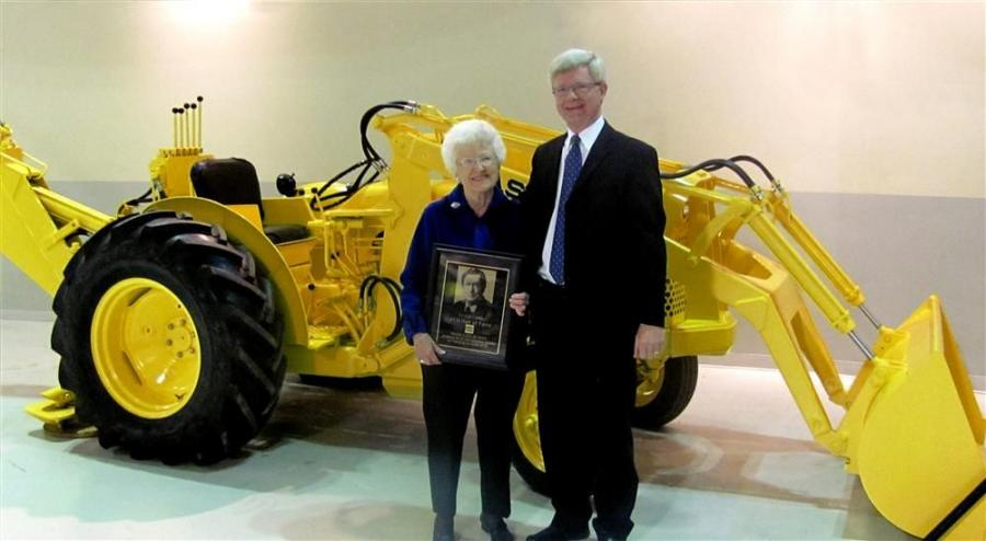 Sue Long, widow of Elton Long, and Sandy Mill, Long's son-in-law, display a replica plaque honoring Long's induction into the AEM Construction Equipment Hall of Fame. They received the plaque during a Nov. 8 ceremony at the Case Construction E