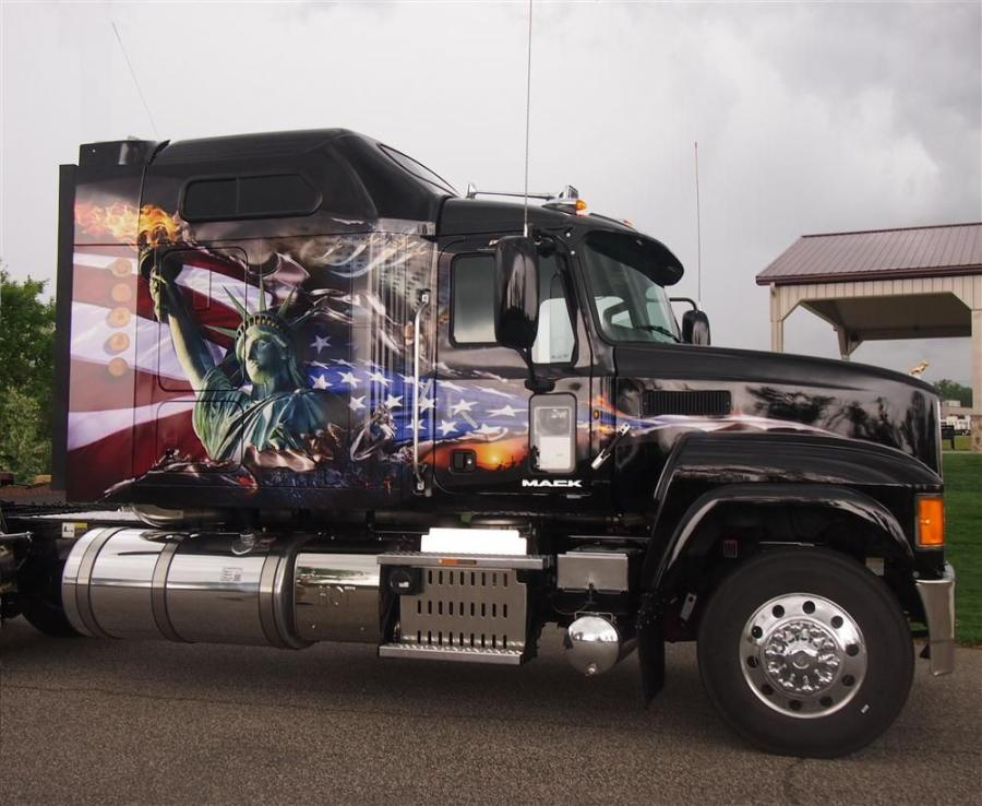 A Mack Pinnacle axle forward model was used as a tribute truck and featured a commemorative decal of the Statue of Liberty with the American flag waving majestically in the background.