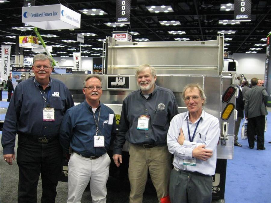 (L-R): J&J Truck Bodies and Trailers' Ron Wright and Chris Durborow catch up with Al Adam and Paul Statler of U.S. Municipal.