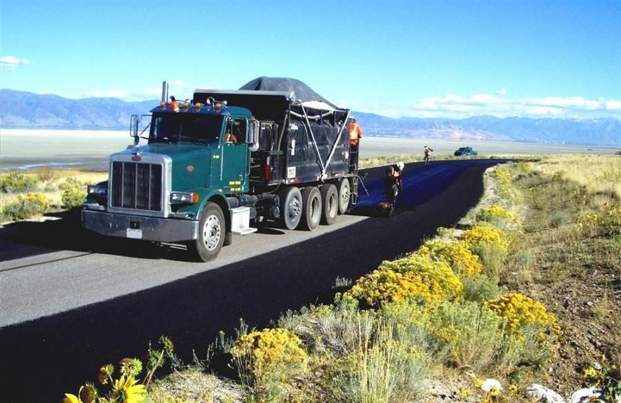 The truck-mounted M210 can carry 10.5 cu. yd. (8.0 cu m) of aggregate in a level struck load, 600 gal. (2,271 L) of asphalt emulsion and 600 gal. of water.
