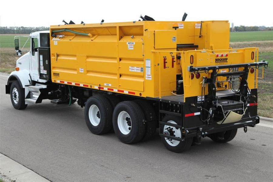 The truck-mounted M212 can carry 12 cu. yd. (9.2 cu m) of aggregate in a level struck load, 691 gal. (2,616 L) of asphalt emulsion and 691 gal. (2,616 L) of water and features a 65-gal. (246 L) stainless steel additive tank.