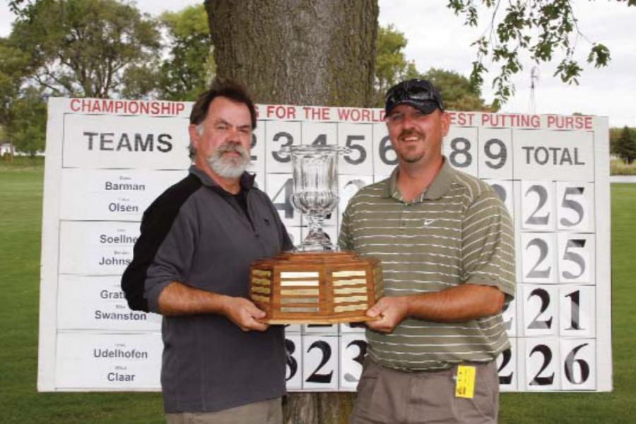 Putting Tournament Champions Mike Swanston (L) of Swanston Equipment Company and Chris Gratton of Kansas Heavy Construction proudly hold their trophy.