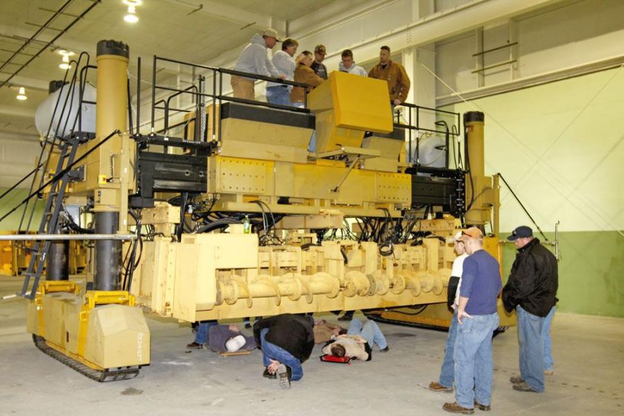 GOMACO University students get a hands-on learning opportunity with a GOMACO GHP-2800 paver during the shop portion of the paver class.