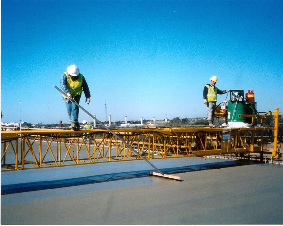 The Terex Bid-Well 2418 places workers low to the concrete surface for quicker, easier hand finishing.