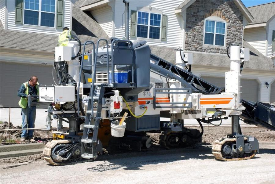 The SP 15 has a maximum paving width of  6 ft. (1.8 m), maximum barrier/parapet placement height of 4 ft. 3 in. (1.3 m), and weighs 27,500 lb. (12,474 kg)