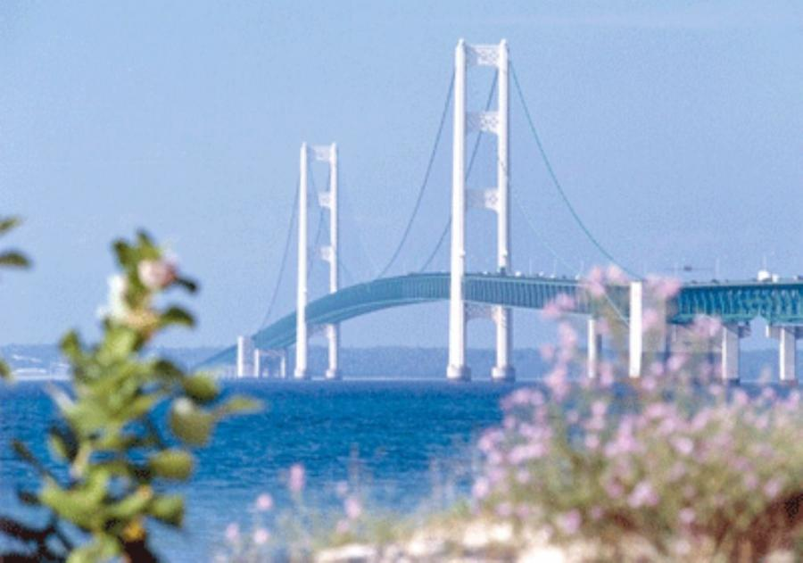 "Observing its 50th anniversary this year, the ""Mighty Mac,"" in Michigan, is one of the nation's greatest bridge- building achievements of