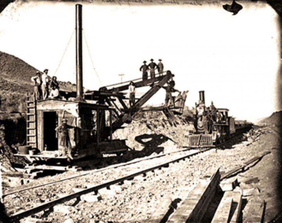 Although the original transcon- tinental railroad was built by hand, this steam shovel, shown below, was employed as crews quickly worked to make the line more permanent. This view at Hanging Rock, Utah, on the Union Pacific was believed to have been taken in the summer of 1869.