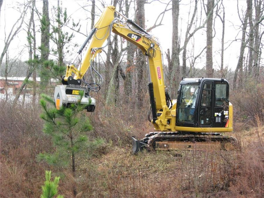 Operating a Caterpillar mini-excavator and demonstrating the new FAE DML/HY125 mini-excavator mulching head with fixed teeth is FAE USA service technician Jason Garland.
