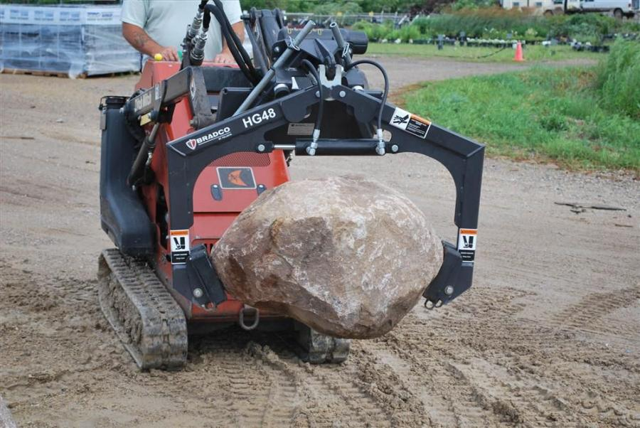 As a hydraulically-powered alternative to forks, pry bars and brute strength, the attachment's grapple arms and rubber grips adjust automatically to the shape and contour of the material being grasped without additional positioning.
