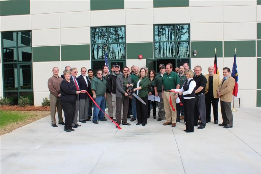 Constantino Lannes, president of Sennebogen LLC and the team cut the ribbon to open the newly expanded facility in Charlotte, N.C.