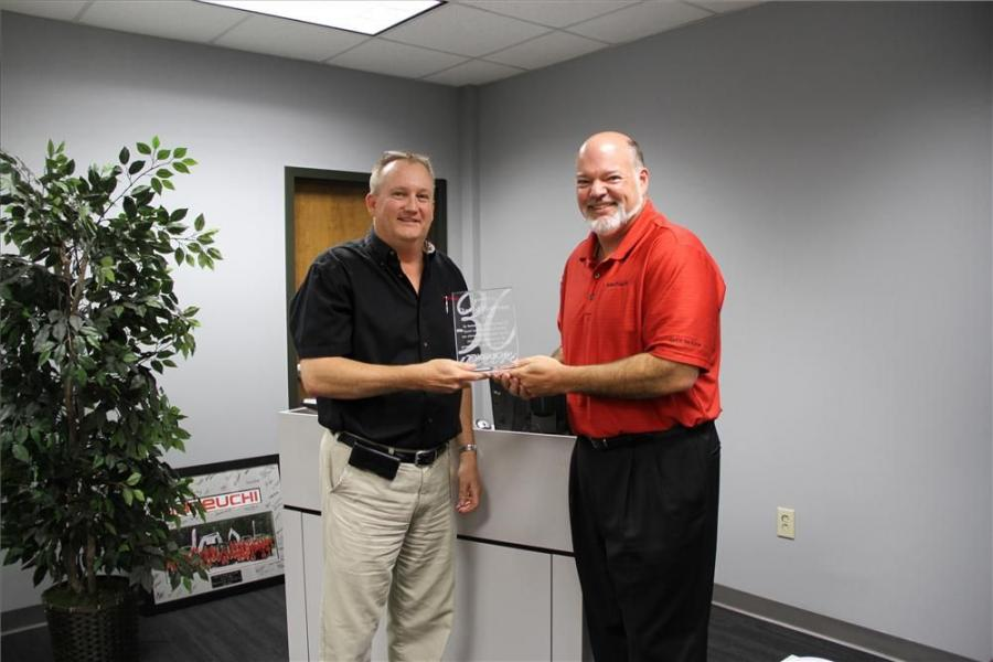David Pearson (L) received an award recognizing 30 years of service from Clay Eubanks.