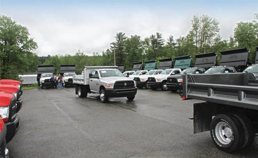 "As part of the ""Dump Truck Driveaway"" event, Dodge Ram Commercial Truck Specialists met at the Robert Green Truck Division headquarters to pick up and deliver the 50 plus E-tipper outfitted trucks to dealerships throughout New York, New Jersey"