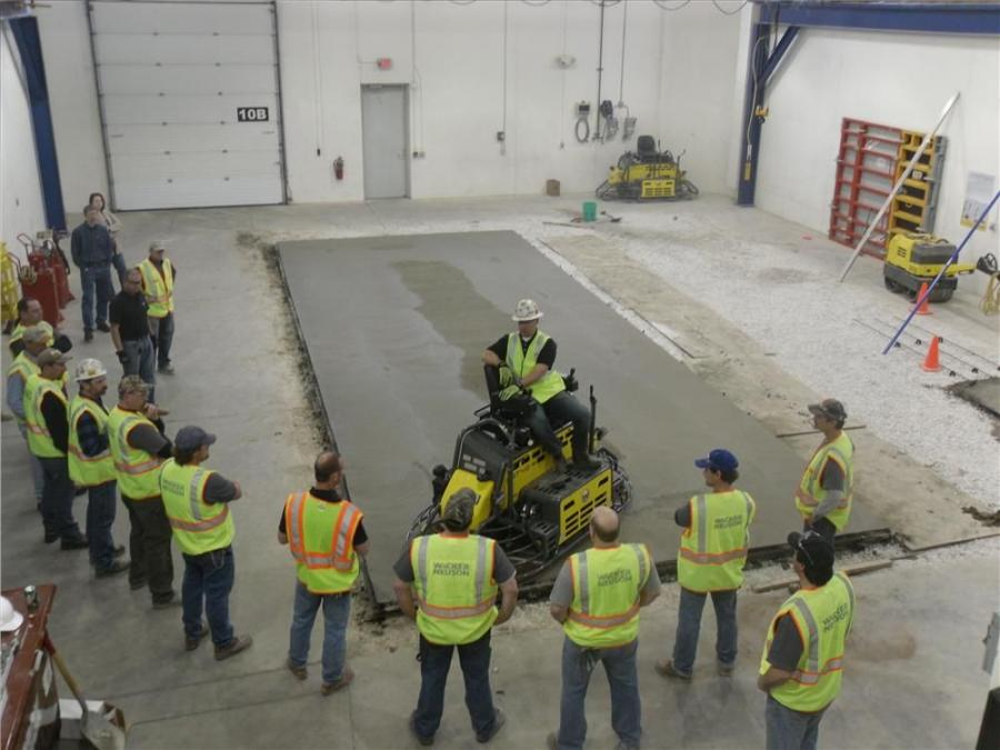 Bryan Birdwell, 17-time golden trowel award winner works with students at the Wacker Neuson Technical Academy. Birdwell and Wacker Neuson have partnered to offer concrete contractors a comprehensive training course to prepare for the ACI Specialty Commerc