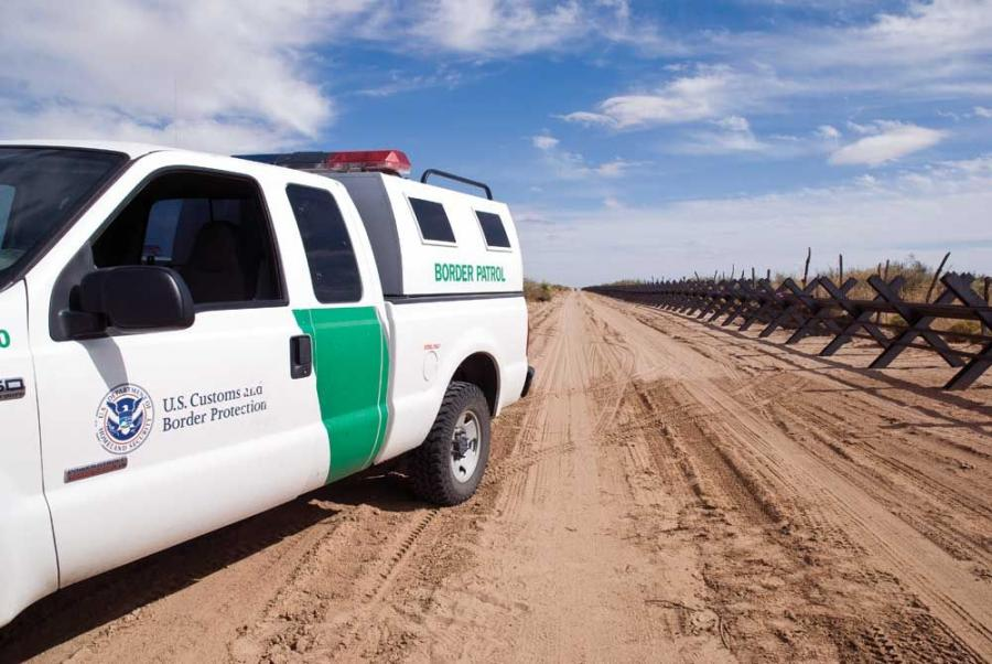 The border fence is designed to stop vehicles while allowing wildlife passage.
