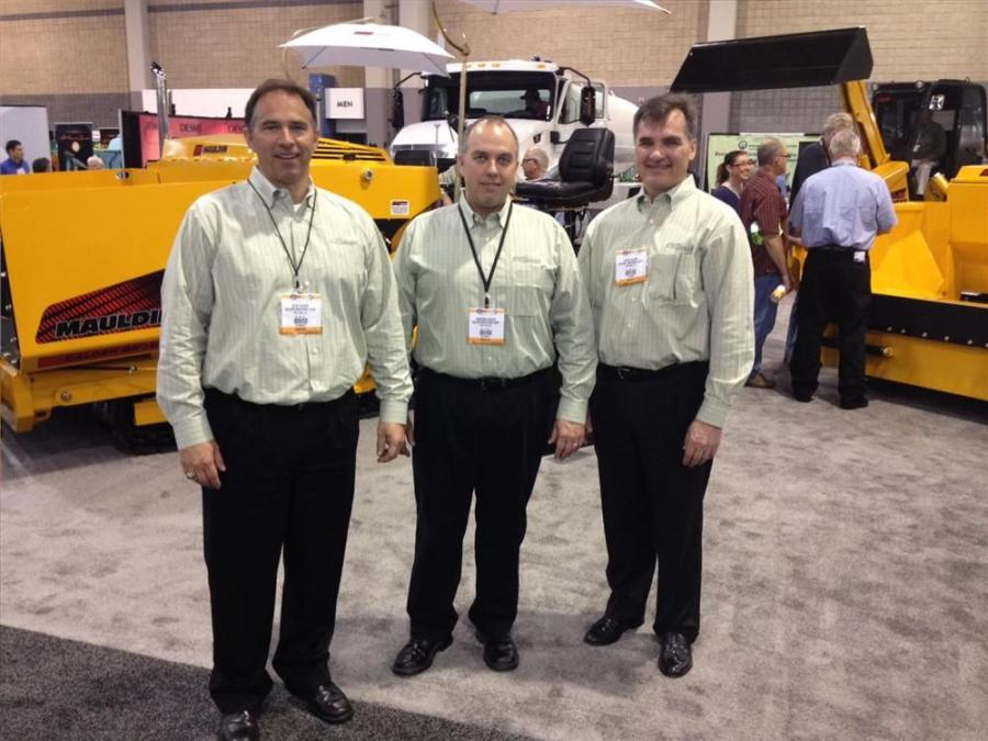 Calder Brothers, Greenville, S.C., manufactures of Mauldin Paving Products, had many of their machines on display. Ready to help are (L-R) Glen, Cameron and David Calder.