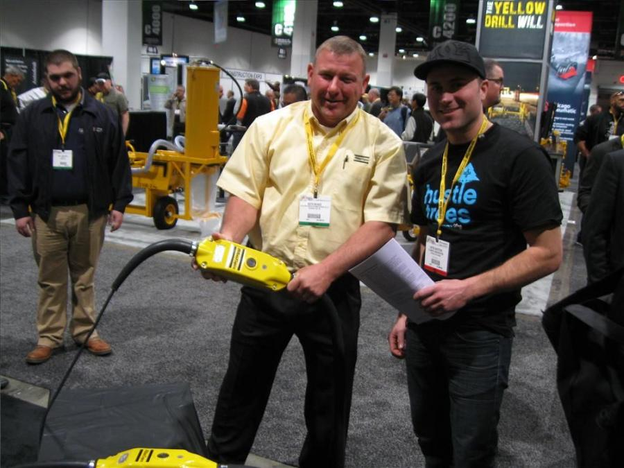 Keith Becker (L), Atlas Copco, points out the attributes of the Smart Poker concrete vibrator to Curtis Goyetche, Fillmore Construction, Edmonton , Canada.