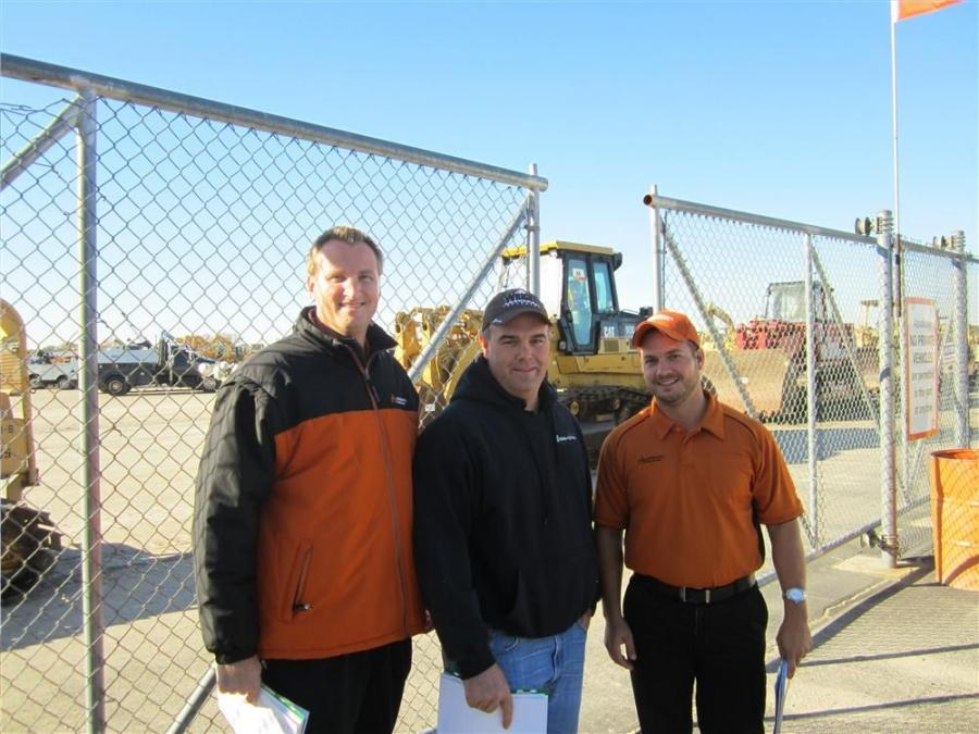 (L-R): Kieran Holm, Ritchie Bros.; Jeremy Walker, Walker Ag Group; and John Beasley, Ritchie Bros.; head out to the yard to show Walker some of the iron.