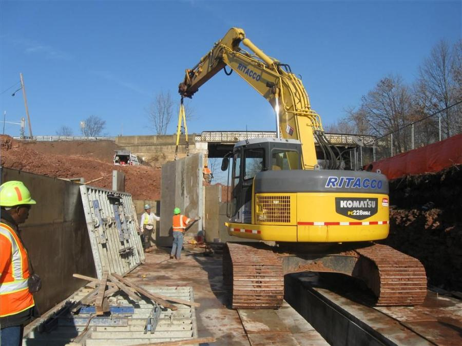 Crews form and pour the footings and abutment walls.