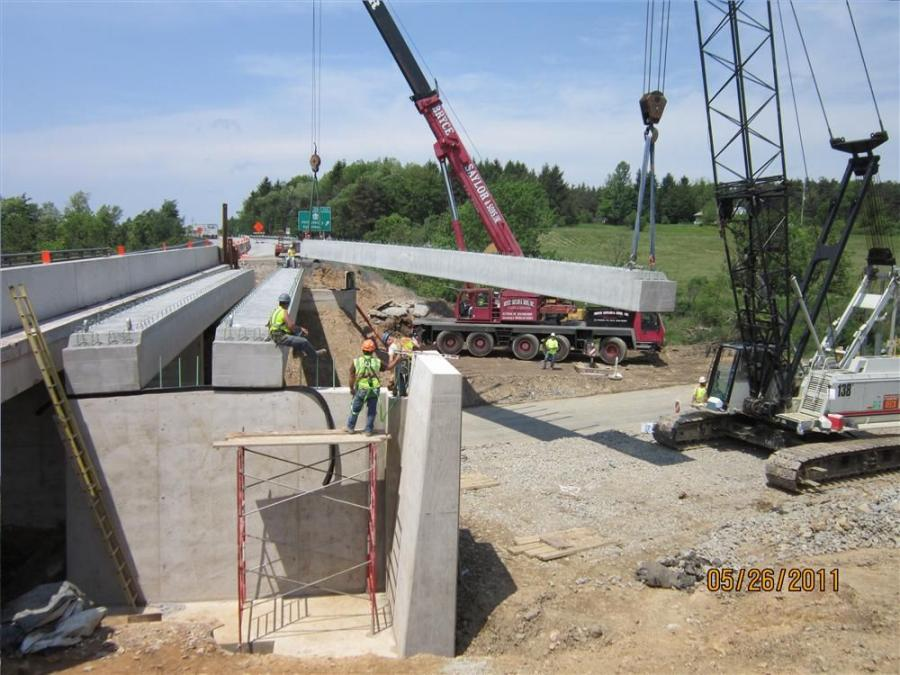 Glenn O. Hawbaker Inc. used an LB138 80-ton (72.5 t) crane and a rented a 175-ton (158.7 t) crane to set the concrete beams on the westbound bridge over SR 2037.