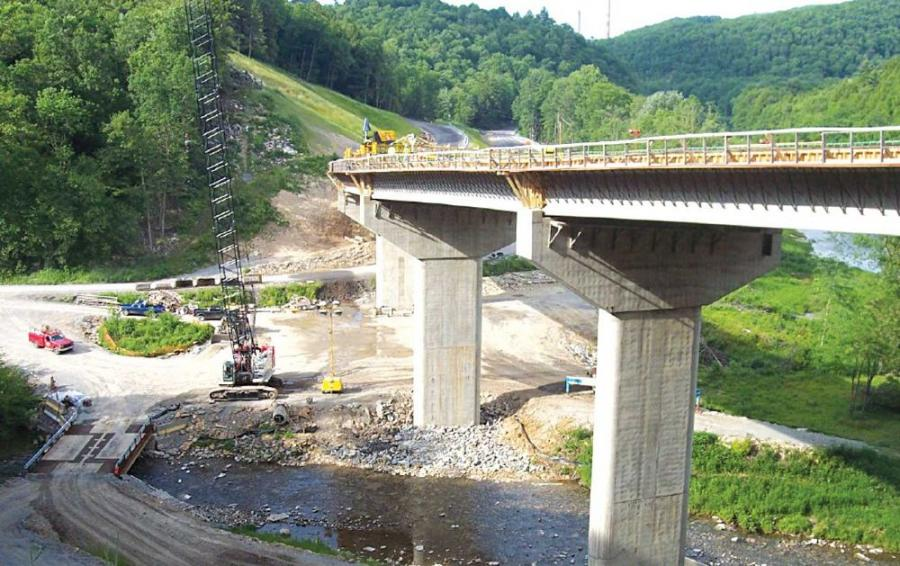 The temporary construction access bridge over Lick Run Creek allows construction vehicles like this Link-Belt 110-ton (99.8 t) crane to reach the work site.