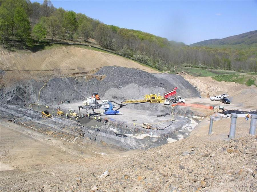 The contract calls, in part, for the rehabilitation of the flood control and water supply dam, which includes flattening both the upstream and downstream slopes to improve stability of the embankment.