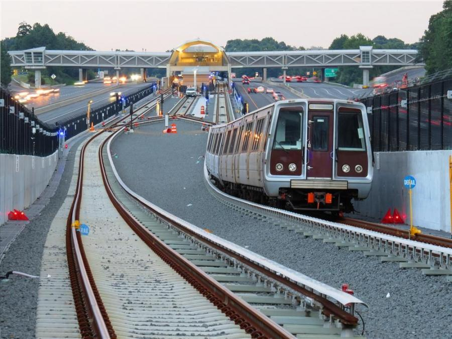 Chuck Samuelson/Dulles Metrorail Corridor Project photo. One of the Silver Line test trains operates near the end of the new line at Wiehle-Reston East station.