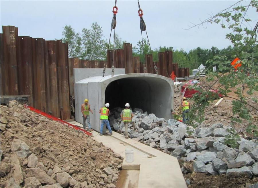 A section of precast arch culvert is set into place. The culvert will be extended across the entire width of Route 903.