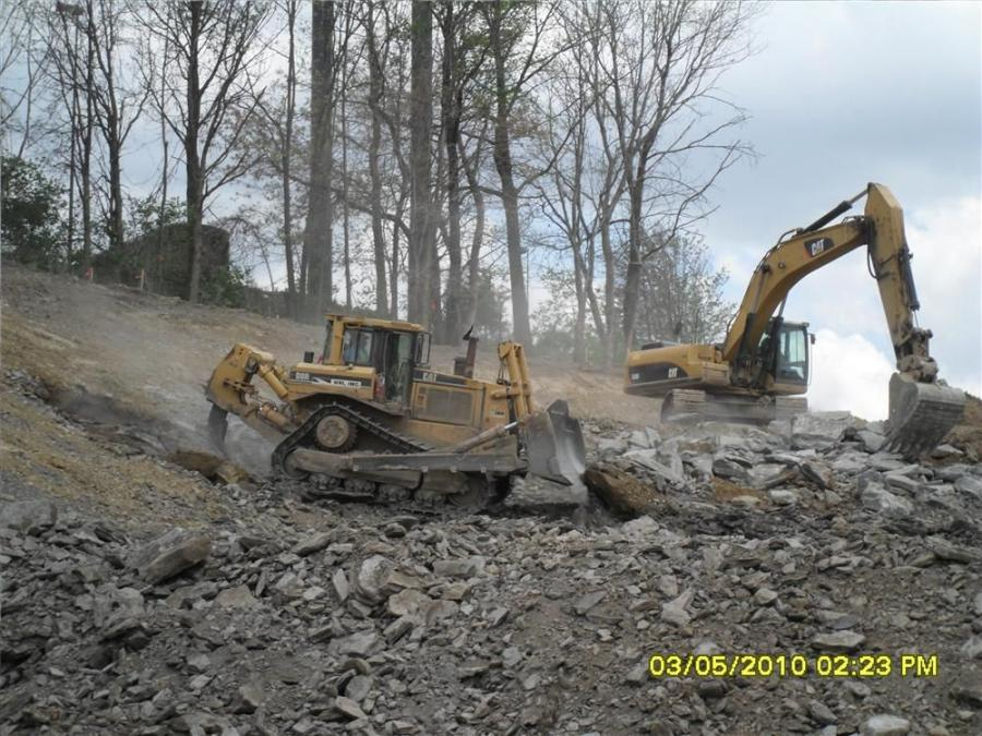 HRI used a Caterpillar D8 dozer and a Caterpillar 330D to excavate the rock slope on the I-80 westbound off ramp. This material was used to construct the fill benches that the westbound on-ramp and eastbound off-ramps were built on.