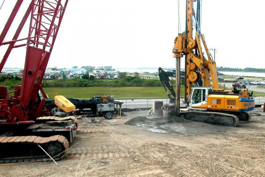 (Dave Duke/DelDOT photo) Crews drill a hole for the casing unit of a pile.