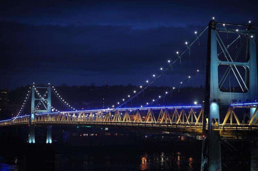 The Market Street Bridge in the Northern Panhandle of West Virginia lights up the night sky with its array of blue and white lights. The lights were included as part of a $16.5 million refurbishment project that was completed in late 2011. Photo Courtesy