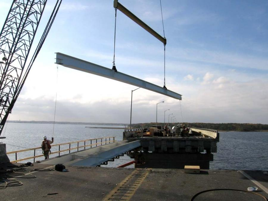 """Among the equipment was the """"Cape Fear,"""" a water rig friction crane, which can lift 250 tons (226.8 t)."""