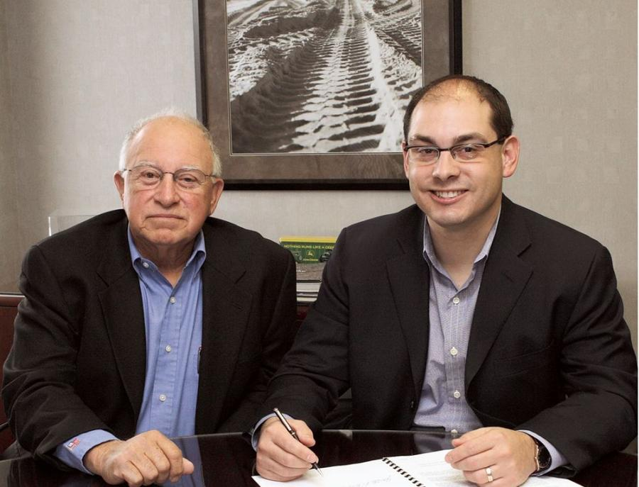 Lou and Jon Robustelli sign the contract in 2005 naming Jon the new president of JESCO.