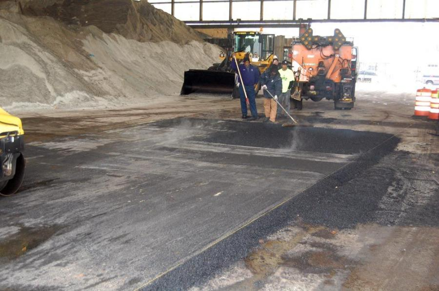 Asphalt from the Bagela being used to resurface the floor of the city of Rochester's salt shed.