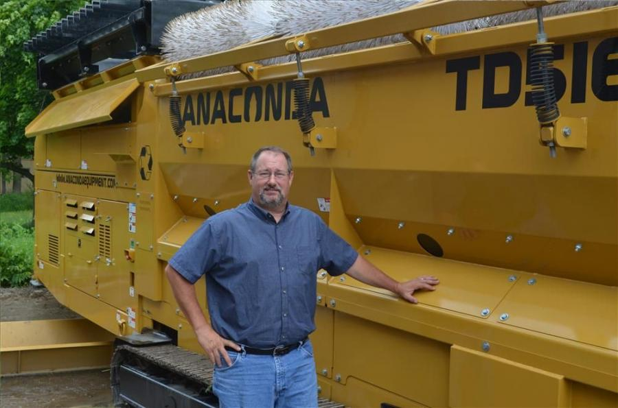 Mike Peters, sales manager of Baschmann Services aggregate division, is ready for all of his customers to see the quality lineup of Anaconda products, including this TD516 trommel screen.