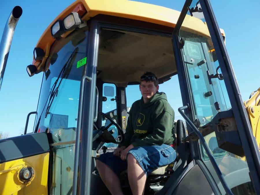 Rick Ryder of Ryder's Backhoe, Chambersburg, Pa., checks out the controls of this John Deere 310SG.