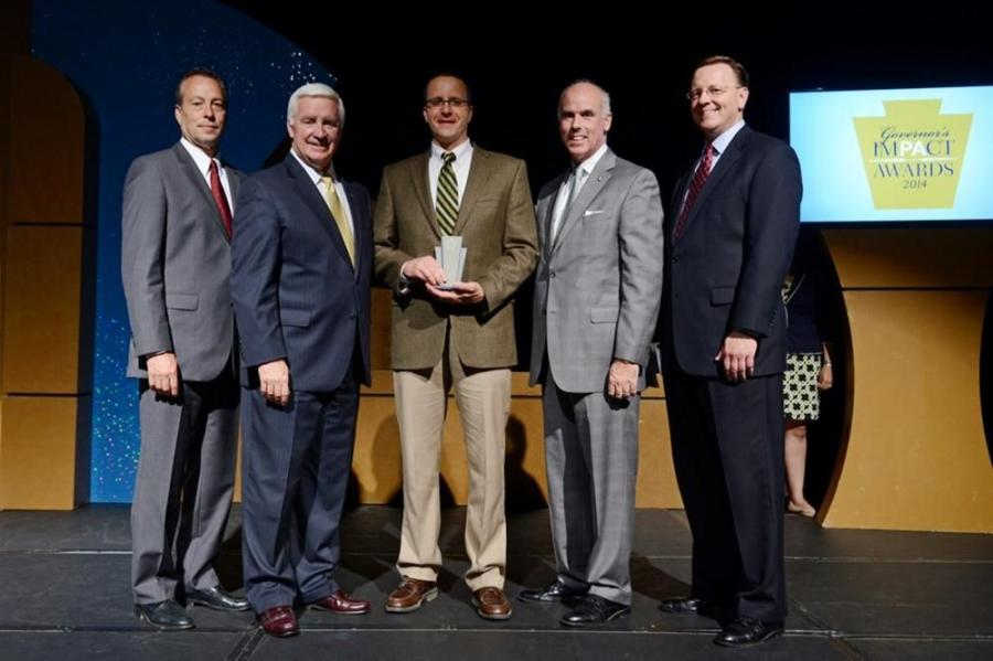 Mark Ritchey, Curry Supply principal partner (C) accepts the 2014 Governor's ImPAct Award (L-R) from David J. Karafa, president, PA Operations, FirstEnergy; Gov. Tom Corbett; John D. Moran Jr., president & CEO, Moran Industries Inc. and co-chair, Te