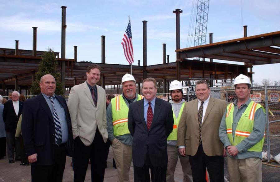 Members of the Norwood team gather to enjoy the topping off ceremony. (L-R) are Harry Kamnik, senior project manager; Eric Urbanski, project executive;  Homer May, superintendent; Tim Kelly, marketing/sales;  Gary Pearce, assistant superintendent; Joe Mit