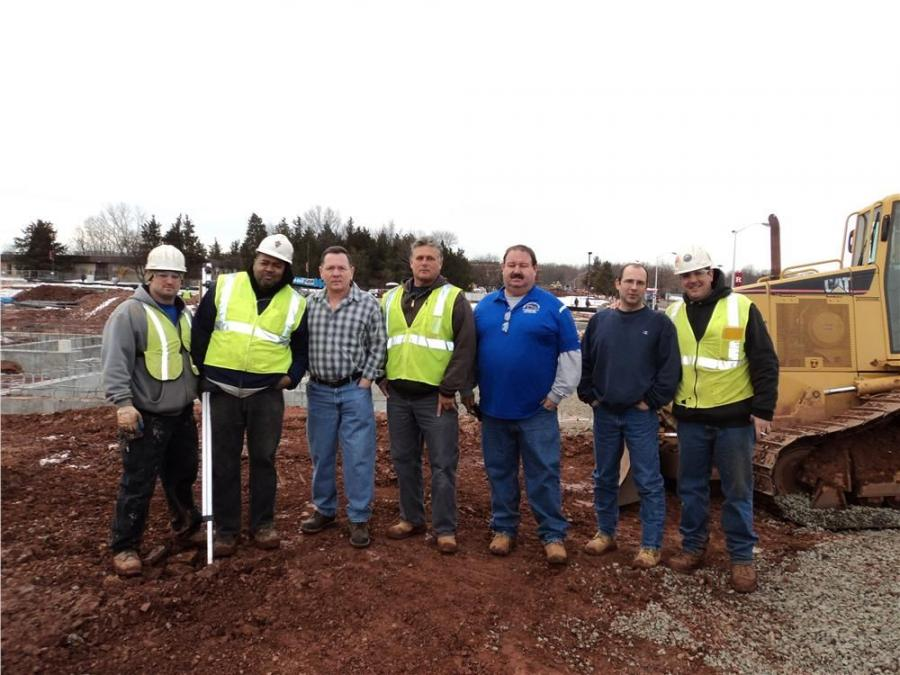 (L-R) are EUC's Bryan Nugent, Joe Polanco, John R. Wallace, Steve Tissot, Bruce Wayne, Tom Nadolsky and Ryan Sibilia.