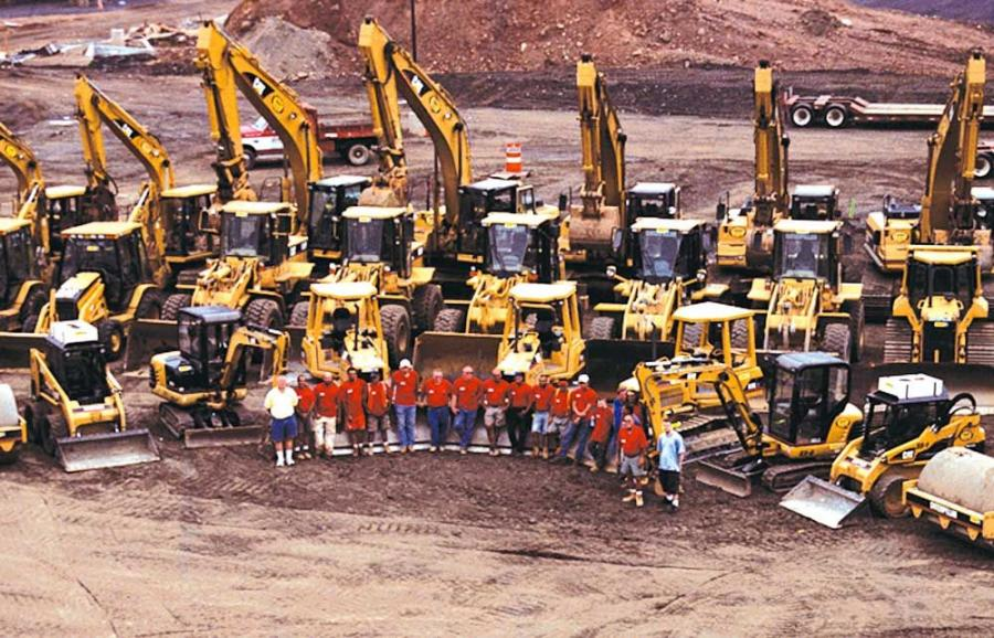 JOMAC employees and its fleet of Cat machines.