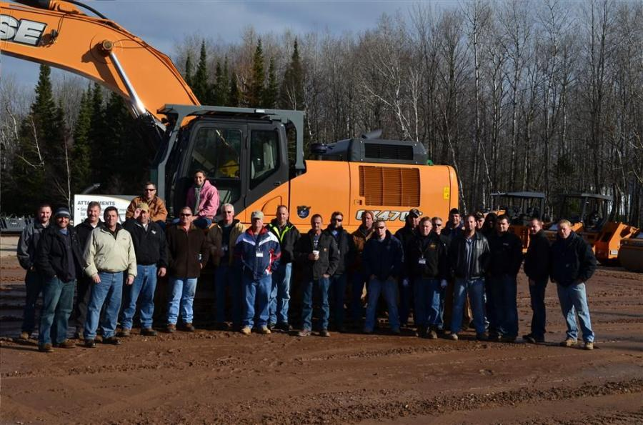 A group photo in front of a new CX470C.