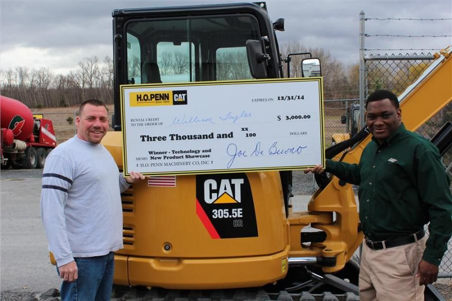 James Bennett (R), H.O. Penn sales representative, congratulates William Taylor on winning the $3,000 rental credit grand prize.