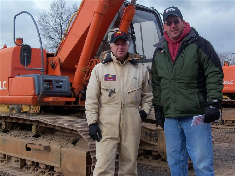 Mike Hunyady (L), president of Hunyady Auction Company, is pictured with long-time friend Gary Linde, vice president of Leeward Construction, Honesdale, Pa., before the auction began on the larger equipment on a cold day in Hatfield, Pa.