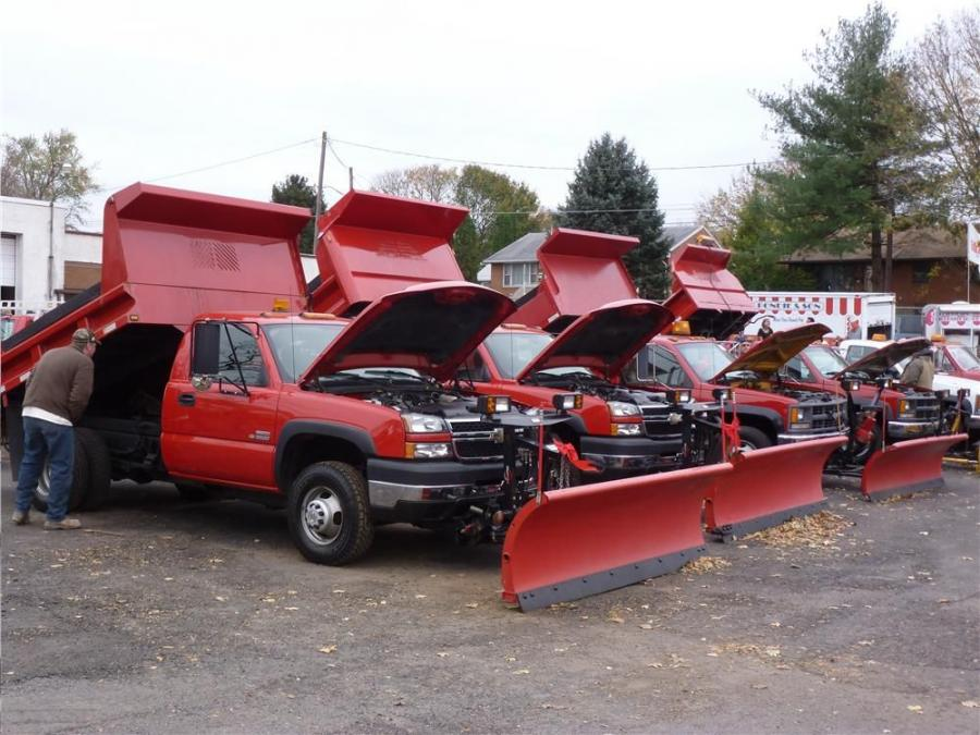 Chevrolet trucks with Mason dump bodies are lined up and ready for new owners. With winter fast approaching, bids were competitive with two of the trucks going for $37,500.