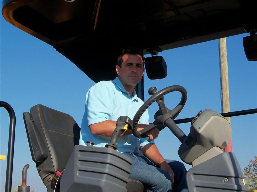 Drew Alleva, an independent contractor from Malvern, Pa., checks out this Cat machine prior to the auction.