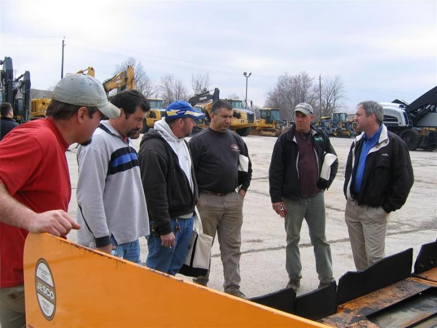 Jim Harkins (far R), northeast territory manager of VT LeeBoy, draws a crowd around a LeeBoy 8515B paver. Throughout the afternoon, Harkins explained the features and benefits of several LeeBoy pavers to interested paving contractors.