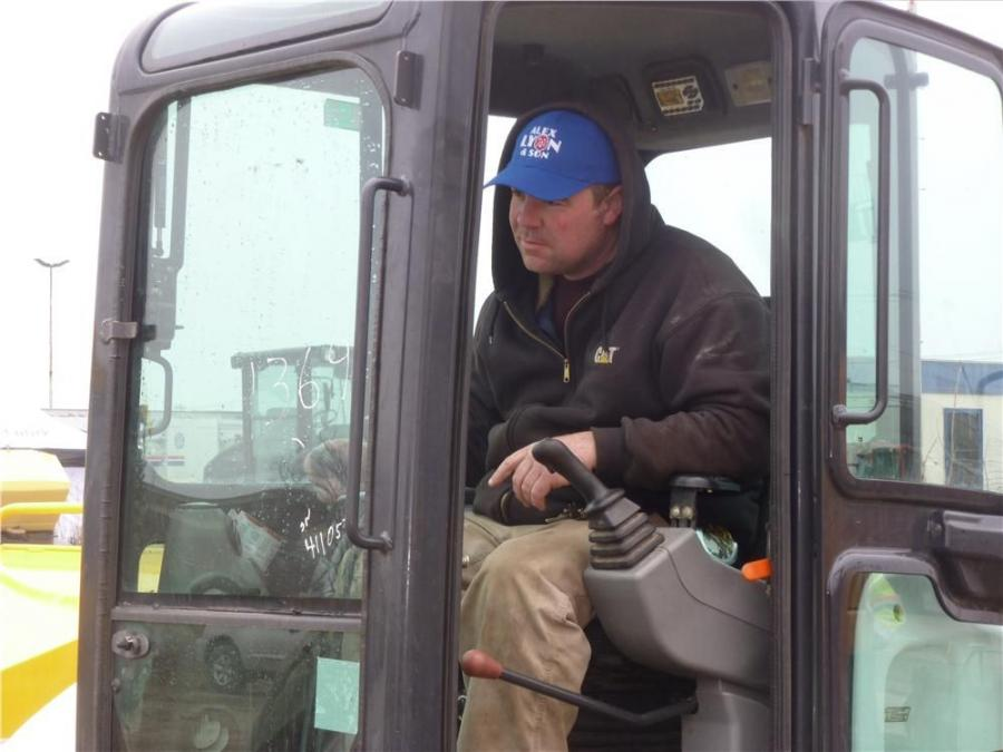 Kevin Duggan of Tir-Eoghain Construction, Philadelphia, Pa., works the controls of a Bobcat mini-excavator.