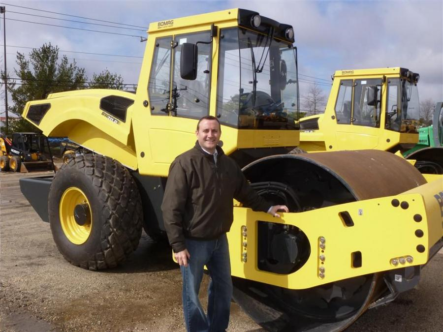 Anthony Falzarano, vice president of sales of JESCO, looks over a Bomag soil compactor.