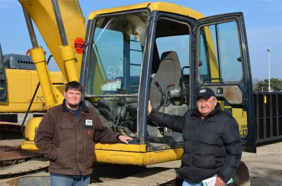 Gene Cosklo (L) and his father of 315 Reality Corp. of Wilkes Barre, Pa., are prepared to test out a Komatsu PC120 hydraulic excavator.